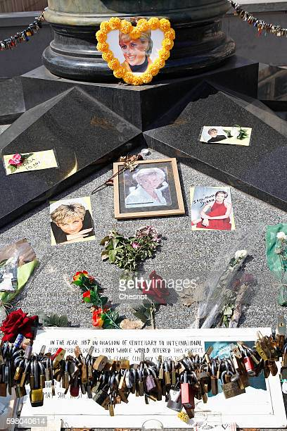 Iconic photos flowers and messages dedicated to pay homage to Lady Diana to the 19th anniversary of her death adorn the plinth of the Flame of...