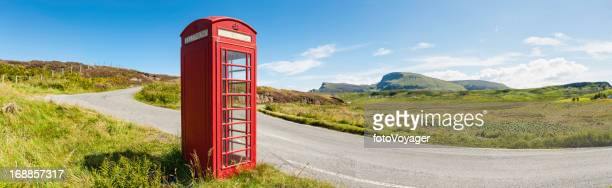 Iconic red phone box in picturesque rural landscape Scotland