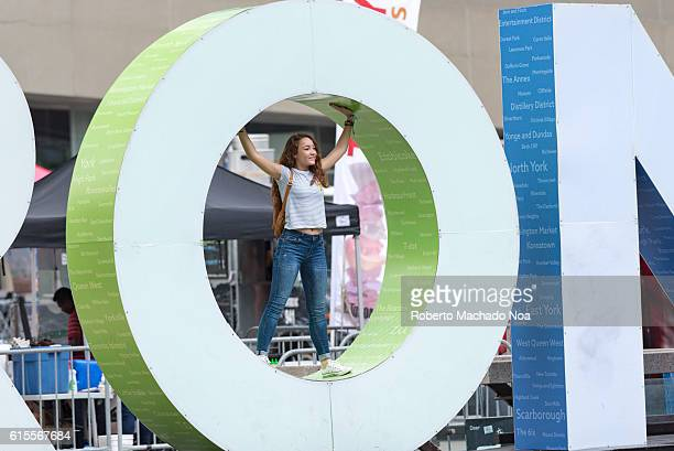 Iconic Toronto 3D sign Young girl posing for picture in typography structure The sign has become a tourist attraction in the Canadian city