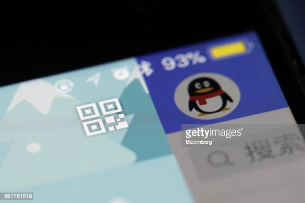 Icons for Quick Response code left and the Tencent Holdings Ltd QQ messaging application are seen in this arranged photograph taken in Hong Kong...
