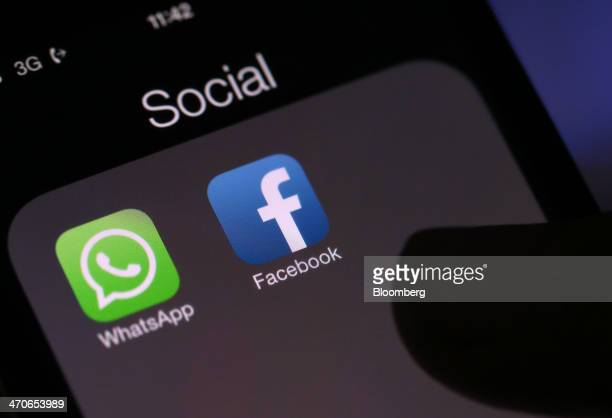 Icons for the WhatsApp Inc mobilemessaging application WhatsApp and the Facebook Inc application are displayed in a social media folder on the screen...