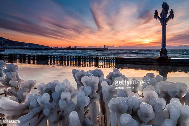 Icy embankment at dawn in a storm