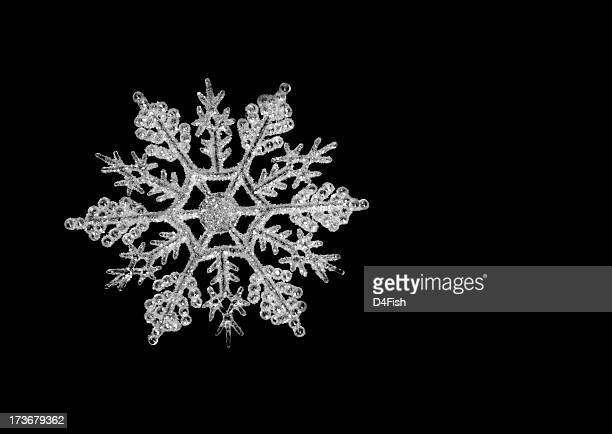 Icy snowflake on a black background