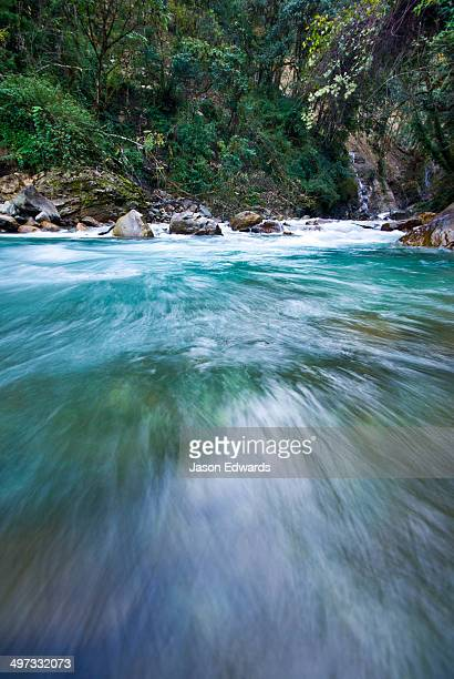 Icy water from snowmelt rushes through a mountain gorge in the Himalaya.