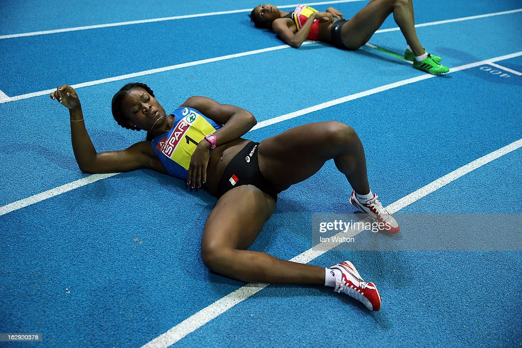 Ida Antoinette Nana Djimou of France lies on the track after competing in the Women's Pentathlon 800m during day one of the European Athletics Indoor Championships at Scandinavium on March 1, 2013 in Gothenburg, Sweden.