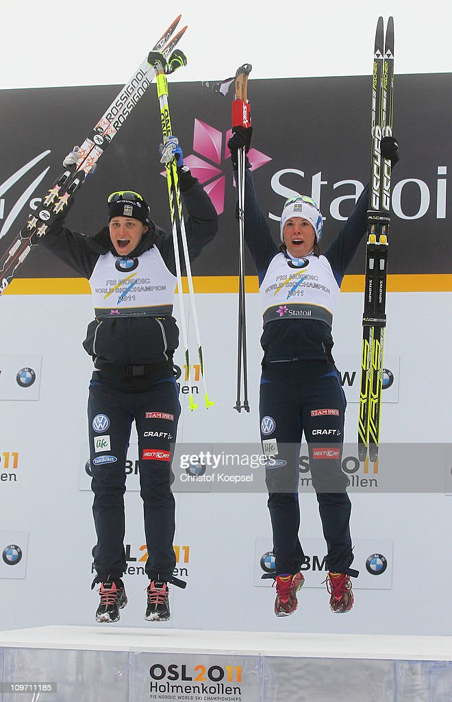 Ida Ingemarsdotter and <a gi-track='captionPersonalityLinkClicked' href=/galleries/search?phrase=Charlotte+Kalla&family=editorial&specificpeople=4081474 ng-click='$event.stopPropagation()'>Charlotte Kalla</a> of Sweden celebrate after winning the gold medal in the Ladies Cross Country Team Sprint race during the FIS Nordic World Ski Championships at Holmenkollen on March 2, 2011 in Oslo, Norway.
