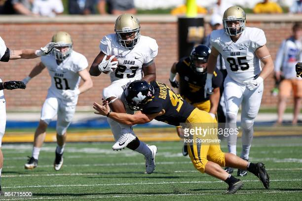 Idaho Vandals running back Aaron Duckworth leaps out of the grasp of Missouri Tigers defensive back Zion Sales during the first half of a football...