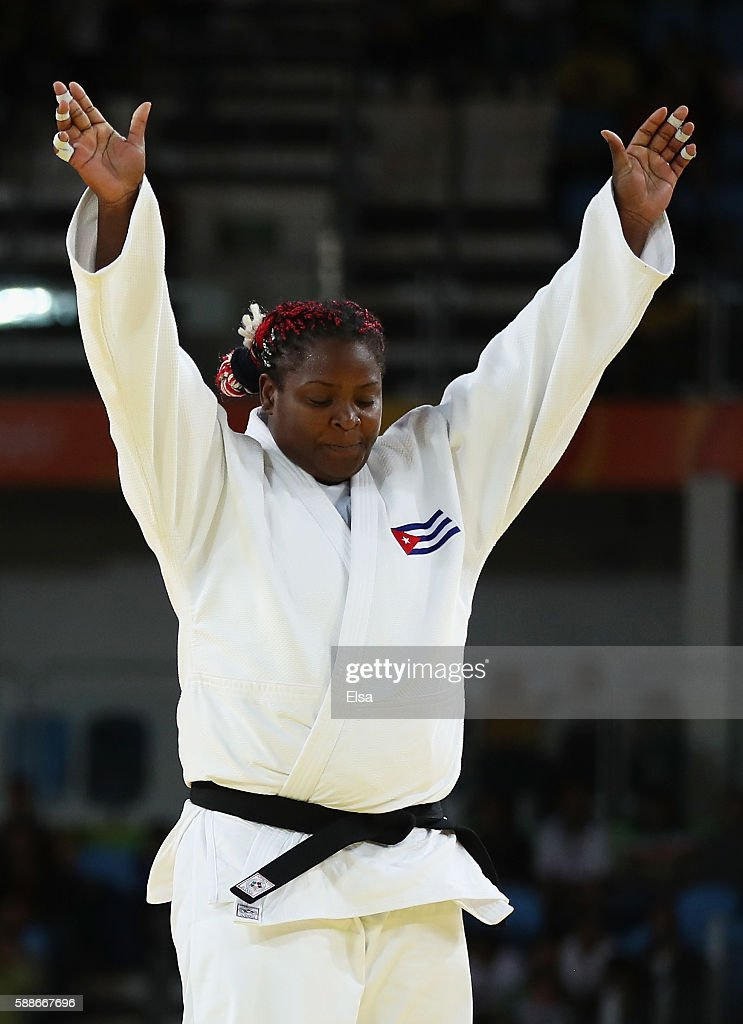 Idalys Ortiz of Cuba celebrates after defeating Minjeong Kim of Republic of Korea in the Women's 78 kg Quarterfinal on Day 7 of the Rio 2016 Olympic...