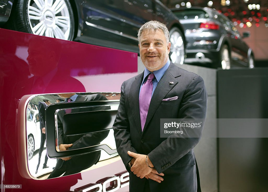 Idan Ofer, billionaire and chairman of Better Place Inc., stands alongside the Qoros 3 automobile, produced by Qoros Auto Co., a joint venture between Chery Automobile Co. and Israel Corp., on the second day of the 83rd Geneva International Motor Show in Geneva, Switzerland, on Wednesday, March 6, 2013. This year's show opens to the public on Mar. 7, and is set to feature more than 100 product premiers from the world's automobile manufacturers. Photographer: Chris Ratcliffe/Bloomberg via Getty Images