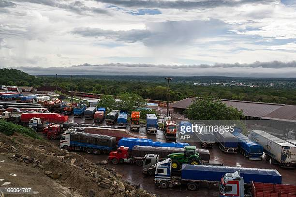 Iddle lorries at the parking lot near the border with Bolivia in Corumba Matto Grosso do Sul state Brazil on April 3 2013 AFP PHOTO/Yasuyoshi CHIBA