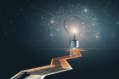 Creative background with arrows and glowing lamp. Idea and innovation concept. 3D Rendering