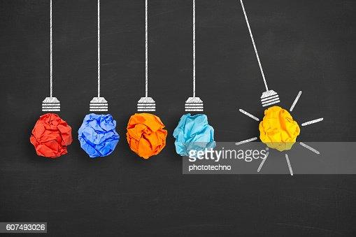 Idea Concept Light Bulb Crumpled Paper on Blackboard : Foto stock