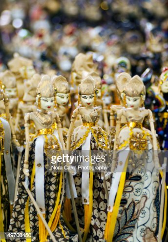 Identical Javanese doll on display : Stock Photo