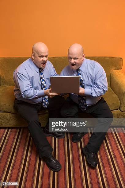 Identical twins working on personal computer