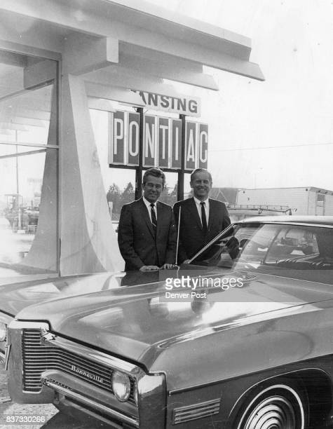 Identities Corrected C F Pansing right who recently opened his new quarters for Pansing Pontiac at 5500 S Broadway and his general sales manager...