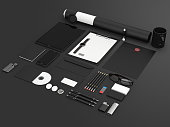 Identity mock up. Set of blank stationery for branding identity on black background. Tablet, smart phone, smart watch, paper A4, CD envelope, letterhead, flash drive, business cards, tube. 3D render.