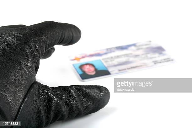 Identity Thief's Hand Reaching for I.D.