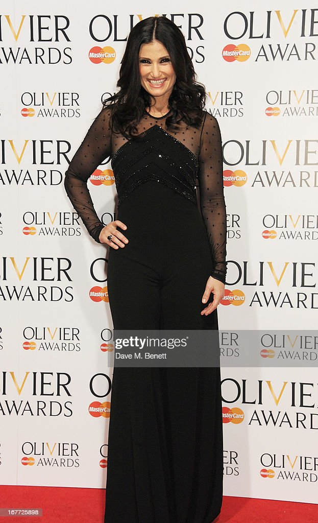<a gi-track='captionPersonalityLinkClicked' href=/galleries/search?phrase=Idina+Menzel&family=editorial&specificpeople=213583 ng-click='$event.stopPropagation()'>Idina Menzel</a> poses in the press room at The Laurence Olivier Awards 2013 at The Royal Opera House on April 28, 2013 in London, England.