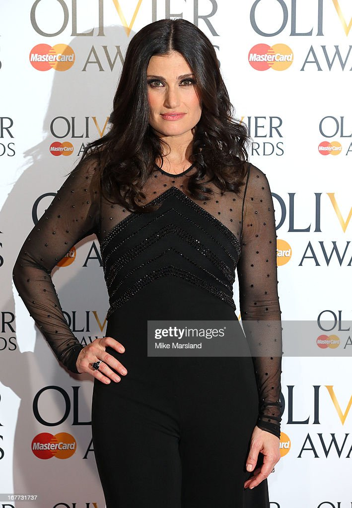 Idina Menzel poses in the press room at The Laurence Olivier Awards at The Royal Opera House on April 28, 2013 in London, England.