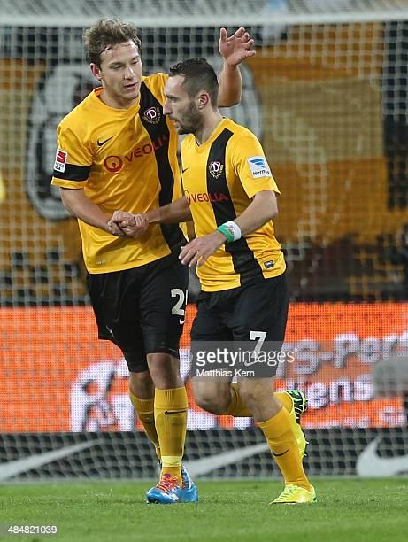 Idir Ouali of Dresden jubilates with team mate Robert Koch after scoring the second goal during the Second Bundesliga match between SG Dynamo Dresden...