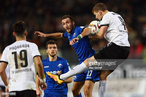 Idir Ouali of Paderborn jumps for a header with Damian Rossbach of Sandhausen during the Second Bundesliga match between SV Sandhausen and SC...
