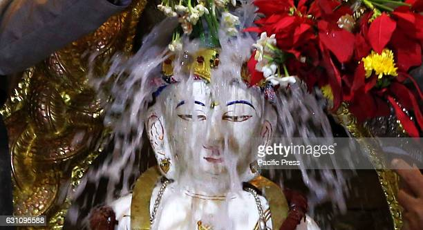 MACHHENDRABAHAL KATHMANDU NEPAL Idol of Seto Machhendranath is seen bathed by priests during religious ritual of annual bathing procession as...