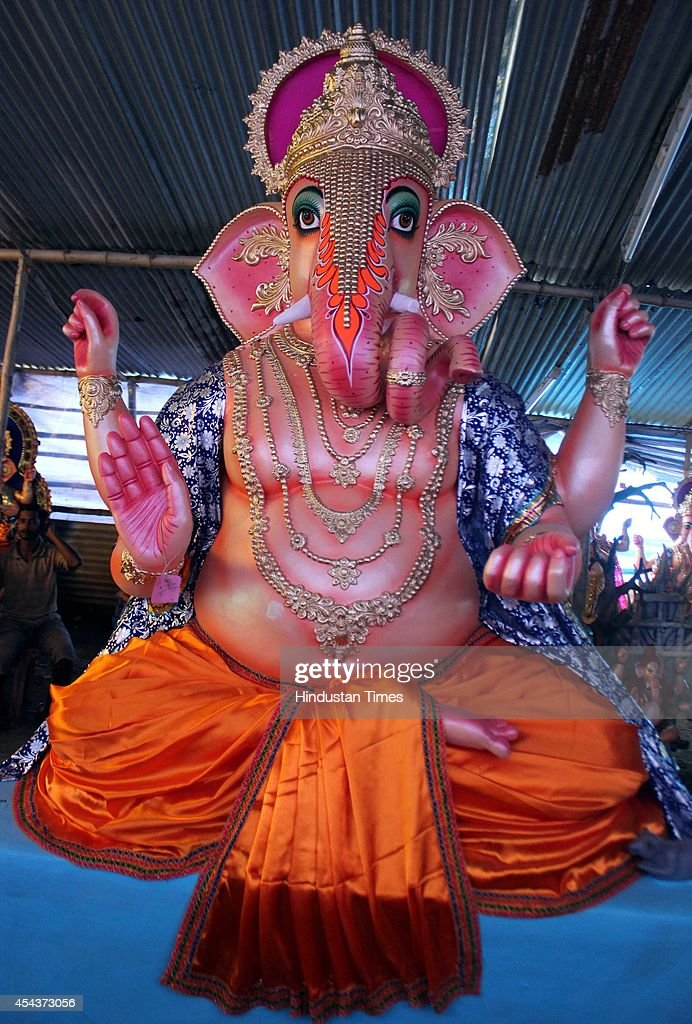 Idols of Ganesha being carried for installation at different puja pandals of city on the occasion of Ganesha Chathurthi festival on August 29, 2014 in Indore, India. The ten-day long Ganesh festival kicked off with zeal and fervour across Maharashtra with lakhs of devotees queueing up outside temples to offer prayers to the elephant-headed deity. The district administration has put a ban of use of idols made from plaster of Paris with a view to prevent pollution of rivers and ponds.