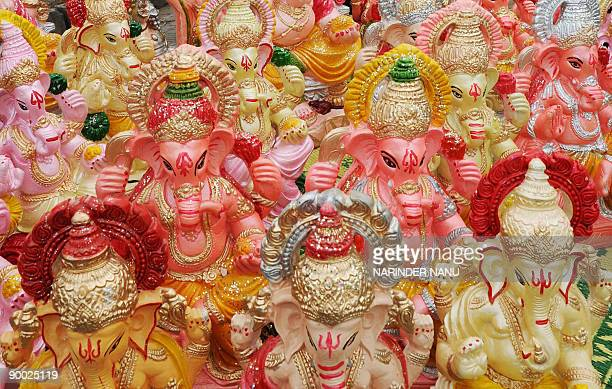 Idols of Hindu god Lord Ganesh are displayed at a roadside stall in Amritsar on August 23 2009 Hindus bring home Lord Ganesha idols in order to...