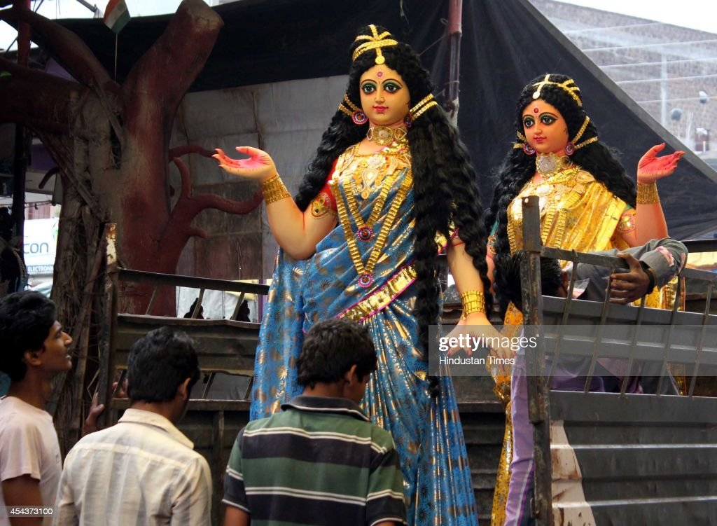 Idols of Ridhi and Sidhi, which are installed with Lord Ganesha idols at different puja pandals of city on the occasion of Ganesha Chathurthi festival on August 29, 2014 in Indore, India. The ten-day long Ganesh festival kicked off with zeal and fervour across Maharashtra with lakhs of devotees queueing up outside temples to offer prayers to the elephant-headed deity. The district administration has put a ban of use of idols made from plaster of Paris with a view to prevent pollution of rivers and ponds.