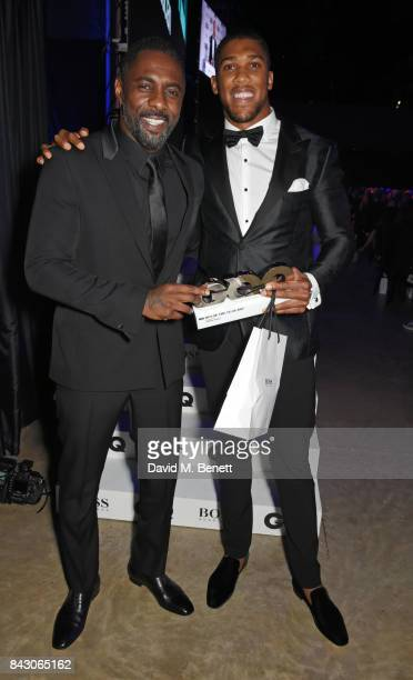 Idris Elba and Anthony Joshua winner of the Sportsman of the Year award attend the GQ Men Of The Year Awards at the Tate Modern on September 5 2017...