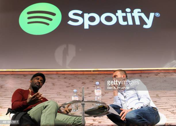 Idris Elba and Chris Maples Spotify VP Europe speak on stage at the Spotify in Conversation with Idris Elba on the ITV Stage at Princess Anne during...