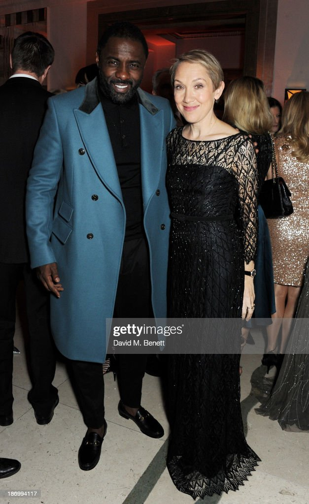 Idris Elba (L) and Justine Picardie arrive at the Harper's Bazaar Women of the Year awards at Claridge's Hotel on November 5, 2013 in London, England.