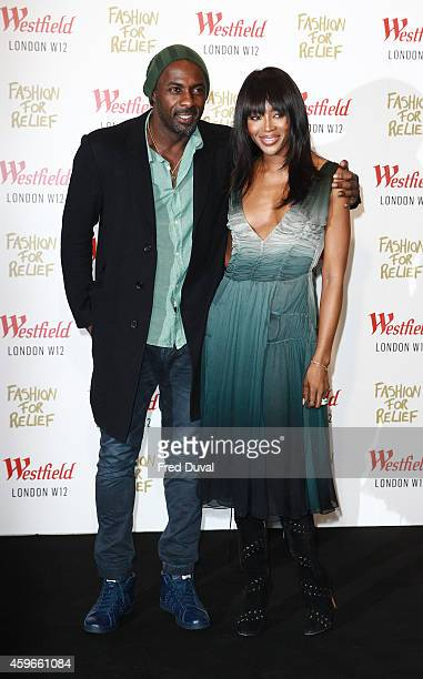 Idris Elba and Naomi Campbell attend the Fashion For Relief at Westfield London on November 27 2014 in London England