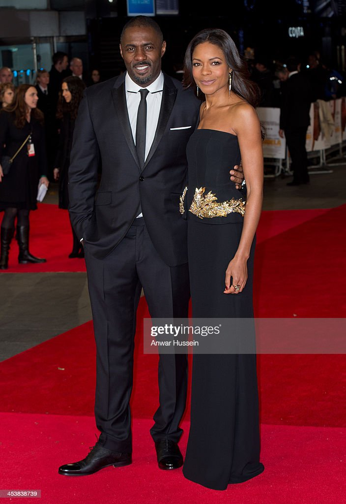 Idris Elba and Naomie Harris attend the Royal film performance of 'Mandela: Long Walk to Freedom' at the Odeon Leicester Square on December 05, 2013 in London, England.