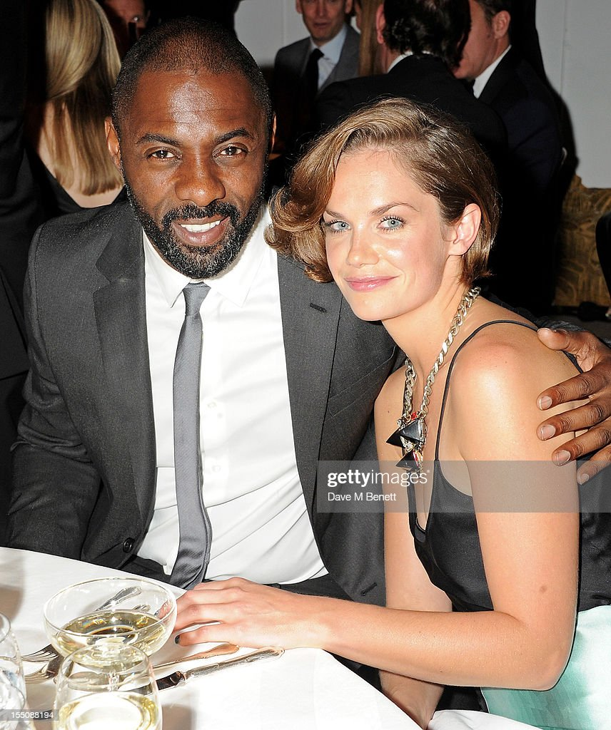 (MANDATORY CREDIT PHOTO BY DAVE M BENETT/GETTY IMAGES REQUIRED) Idris Elba (L) and Ruth Wilson attend the Harper's Bazaar Women of the Year Awards 2012, in association with Estee Lauder, Harrods and Tiffany & Co., at Claridge's Hotel on October 31, 2012 in London, England.