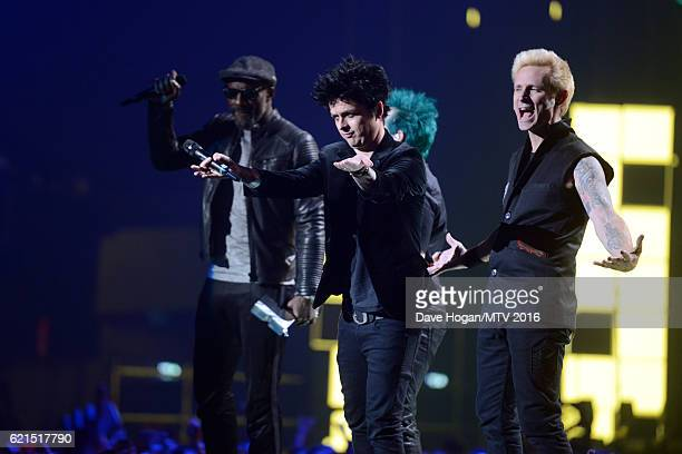 Idris Elba presents Global Icon award to Tre Cool Billie Joe Armstrong and Mike Dirnt of Green Day on stage at the MTV Europe Music Awards 2016 on...