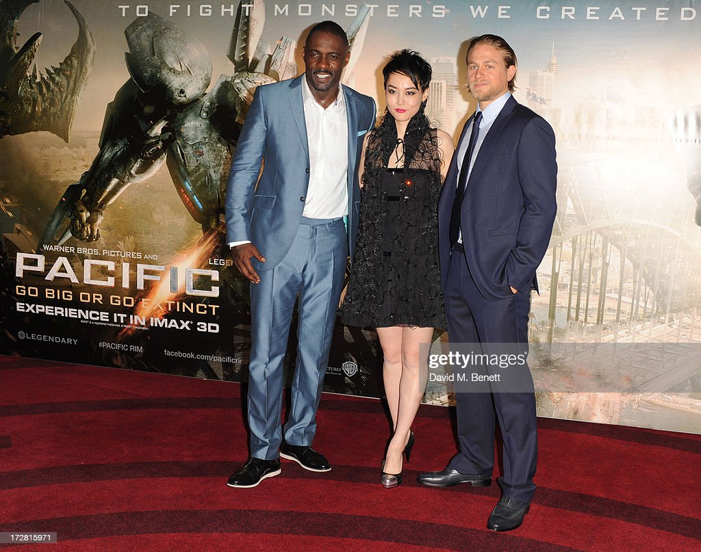 <a gi-track='captionPersonalityLinkClicked' href=/galleries/search?phrase=Idris+Elba&family=editorial&specificpeople=215443 ng-click='$event.stopPropagation()'>Idris Elba</a>, <a gi-track='captionPersonalityLinkClicked' href=/galleries/search?phrase=Rinko+Kikuchi&family=editorial&specificpeople=616782 ng-click='$event.stopPropagation()'>Rinko Kikuchi</a> and <a gi-track='captionPersonalityLinkClicked' href=/galleries/search?phrase=Charlie+Hunnam&family=editorial&specificpeople=223913 ng-click='$event.stopPropagation()'>Charlie Hunnam</a> attend the European Premiere of 'Pacific Rim' at BFI IMAX on July 4, 2013 in London, England.