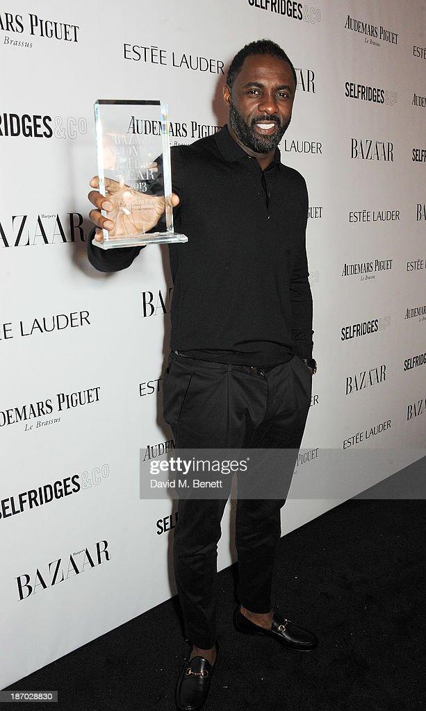 Idris Elba, winner of the Man of the Year award, attends the Harper's Bazaar Women of the Year awards at Claridge's Hotel on November 5, 2013 in London, England.