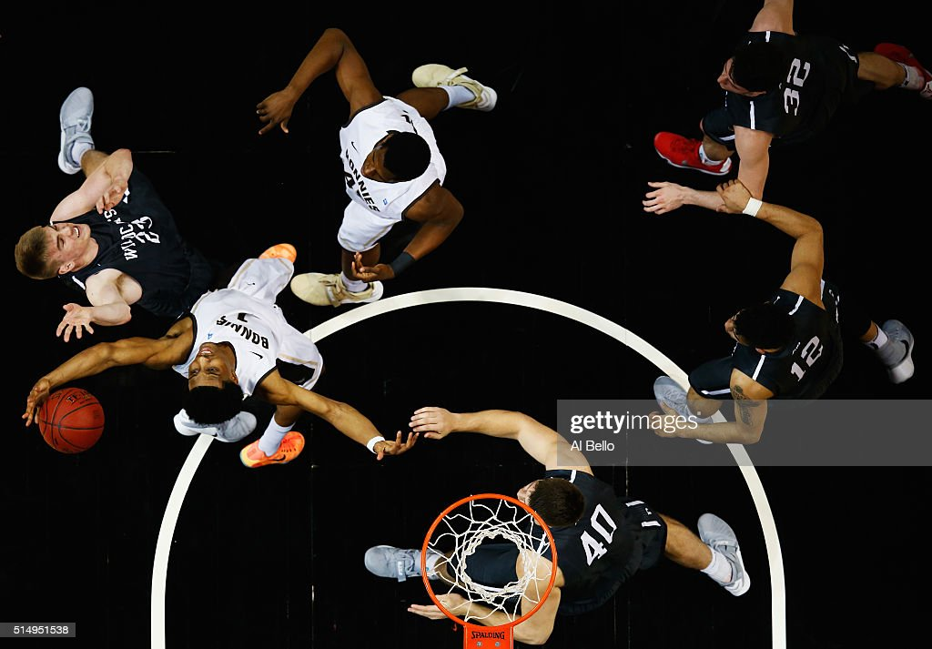 Idris Taqqee of the St Bonaventure Bonnies grabs the ball against Peyton Aldridge of the Davidson Wildcats during the Quarterfinals of the Atlantic...
