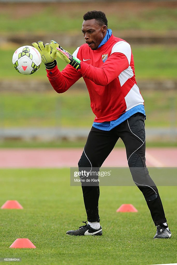 <a gi-track='captionPersonalityLinkClicked' href=/galleries/search?phrase=Idriss+Carlos+Kameni&family=editorial&specificpeople=689971 ng-click='$event.stopPropagation()'>Idriss Carlos Kameni</a> catches the ball during a Malaga CF training session at Santos Stadium on July 24, 2014 in Adelaide, Australia.