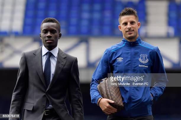 Idrissa Gueye and Kevin Mirallas of Everton arrive before the Premier League match between Everton and Stoke City at Goodison Park on August 12 2017...