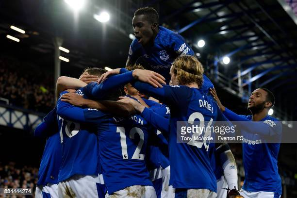 Idrissa Gueye celebrates the goal of Gylfi Sigurdsson during the Premier League match between Everton and Huddersfield Town at Goodison Park on...