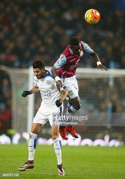Idrissa Gueye of Aston Villa and Riyad Mahrez of Leicester City compete for the ball during the Barclays Premier League match between Aston Villa and...