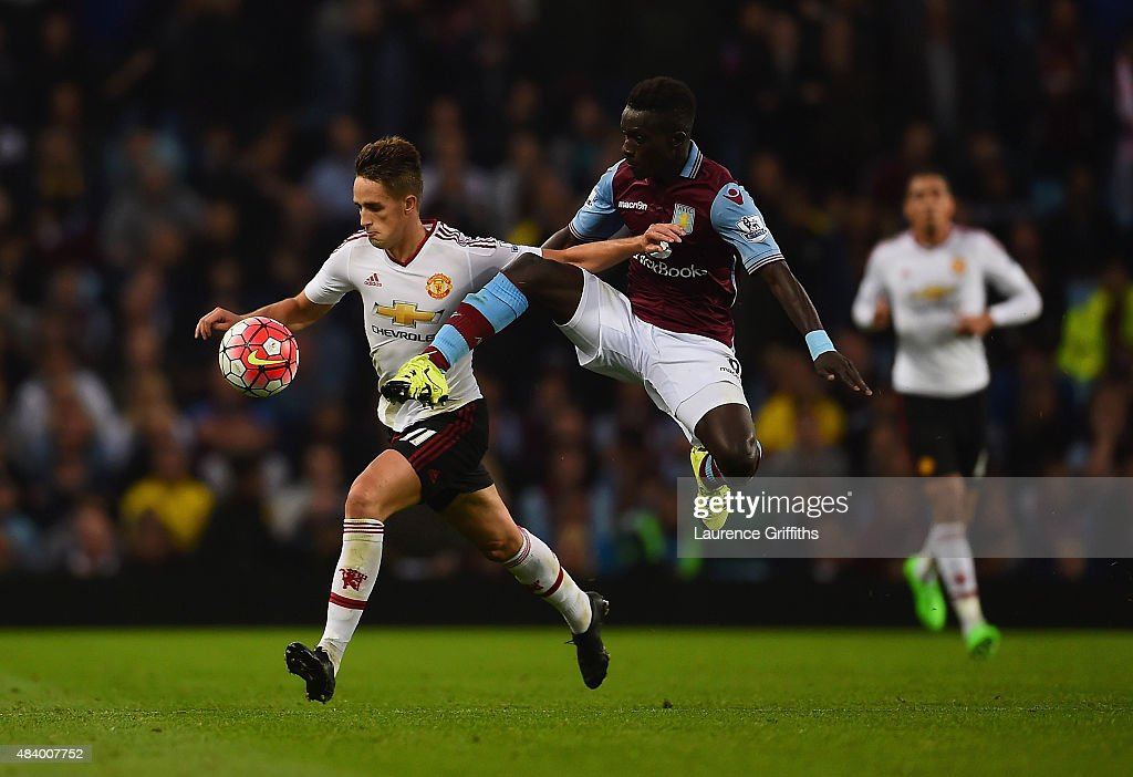 <a gi-track='captionPersonalityLinkClicked' href=/galleries/search?phrase=Idrissa+Gueye&family=editorial&specificpeople=7312174 ng-click='$event.stopPropagation()'>Idrissa Gueye</a> of Aston Villa challenges <a gi-track='captionPersonalityLinkClicked' href=/galleries/search?phrase=Adnan+Januzaj&family=editorial&specificpeople=8291259 ng-click='$event.stopPropagation()'>Adnan Januzaj</a> of Manchester United for the ball during the Barclays Premier League match between Aston Villa and Manchester United on August 14, 2015 in Birmingham, United Kingdom.