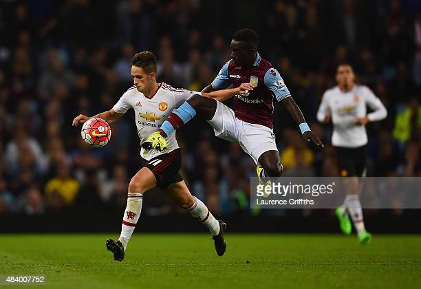 Idrissa Gueye of Aston Villa challenges Adnan Januzaj of Manchester United for the ball during the Barclays Premier League match between Aston Villa...
