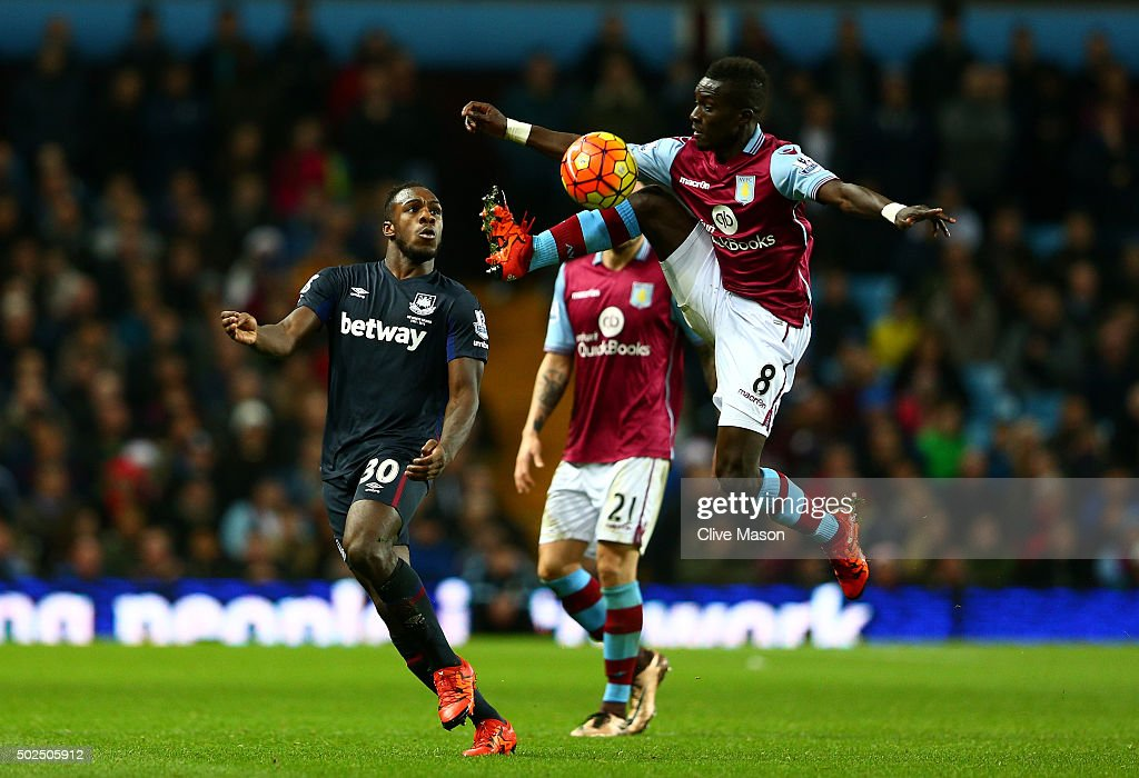 <a gi-track='captionPersonalityLinkClicked' href=/galleries/search?phrase=Idrissa+Gueye&family=editorial&specificpeople=7312174 ng-click='$event.stopPropagation()'>Idrissa Gueye</a> of Aston Villa leaps to control the ball ahead of <a gi-track='captionPersonalityLinkClicked' href=/galleries/search?phrase=Michail+Antonio&family=editorial&specificpeople=5806303 ng-click='$event.stopPropagation()'>Michail Antonio</a> of West Ham United during the Barclays Premier League match between Aston Villa and West Ham United at Villa Park on December 26, 2015 in Birmingham, England.
