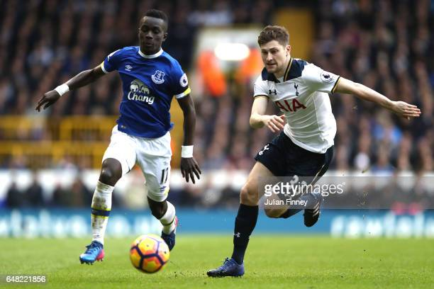 Idrissa Gueye of Everton and Ben Davies of Tottenham Hotspur in action during the Premier League match between Tottenham Hotspur and Everton at White...