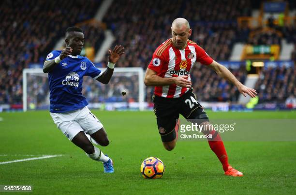 Idrissa Gueye of Everton and Darron Gibson of Sunderland battle for possession during the Premier League match between Everton and Sunderland at...