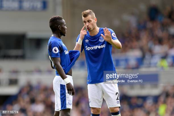 Idrissa Gueye of Everton and team mate Morgan Schneiderlin during the Premier League match between Everton and Stoke City at Goodison Park on August...