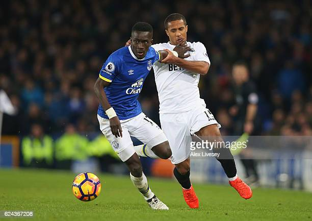 Idrissa Gueye of Everton and Wayne Routledge of Swansea City battle for possession during the Premier League match between Everton and Swansea City...